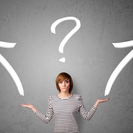 Pretty young woman making a decision with arrows and question mark above her head (1)